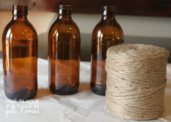 Upcycled Bottle Decor @ Wait Til Your Father Gets Home these #twine wrapped bottles make the perfect decor item in your home for any season #bottles #DIY #upcycle #jute