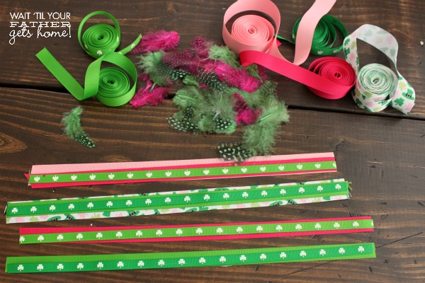 Make a fun & festive ribbon and feather bookmark for your growing stack of books via waittilyourfathergetshome.com #ribbon #feathers #sponsored #bookmark