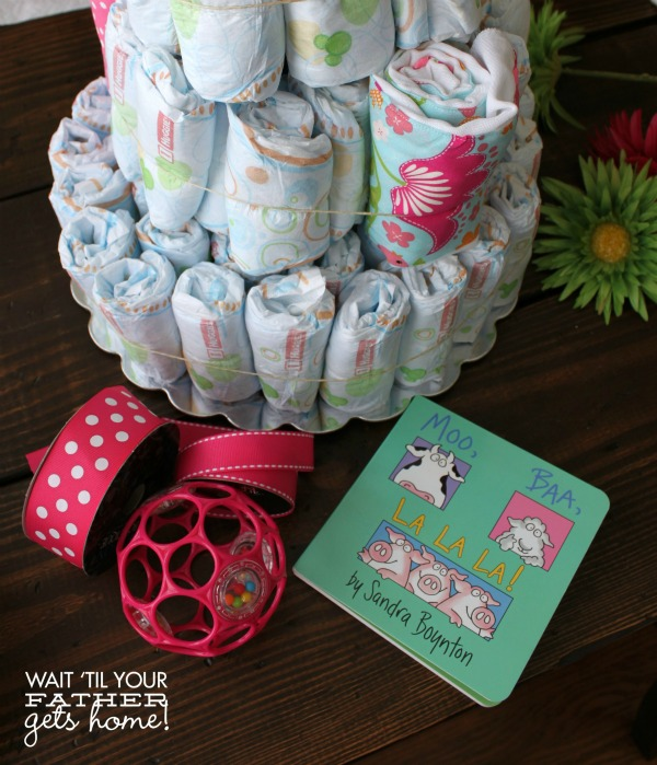 Make a diaper cake for the next baby shower you attend, and it will be the hit of the party from Wait Til Your Father Gets Home! #diapercake #babyshower #babygift